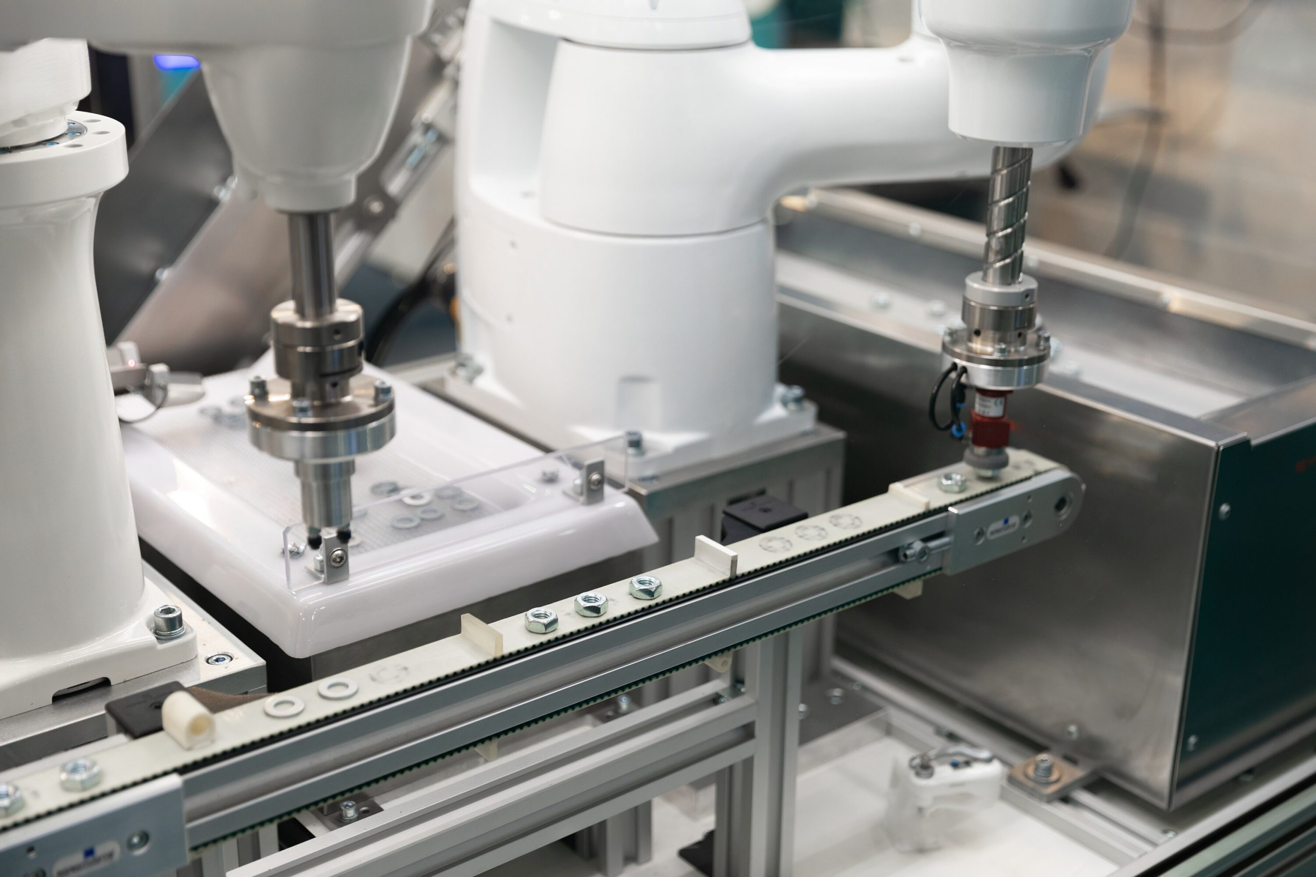 Automatic robot arm working in industrial environment closeup photo